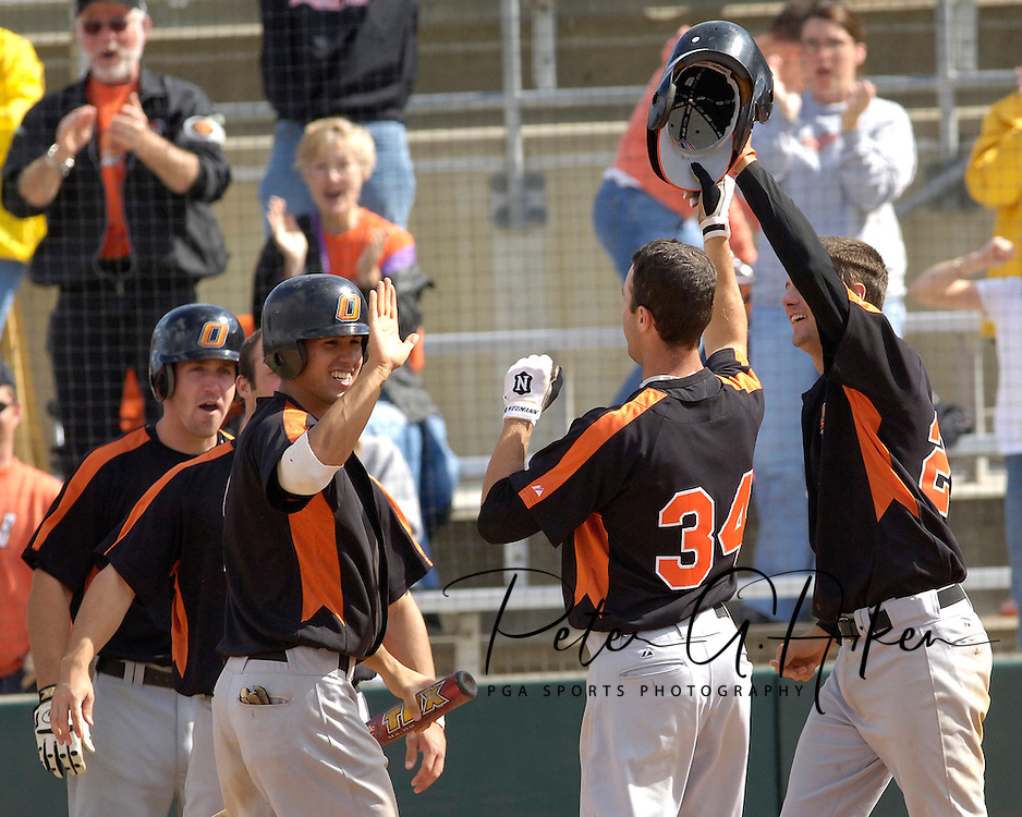 Oklahoma State's Shelby Ford (34) celebrates with his teammates after hitting grand slam against Kansas State in the top of the tenth inning.  Oklahoma State defeated K-State 9-4 in 10 innings at Tointon Stadium in Manhattan, Kansas, April 30, 2006.