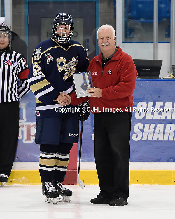 OAKVILLE, ON - Sep 28, 2014 : Ontario Junior Hockey League game action between Newmarket and Toronto Lakeshore at the Govenors Showcase Tournament, Quinn Syrydiuk #52 of the Toronto Patriots Hockey Club player of the game award.<br /> (Photo by Andy Corneau / OJHL Images)