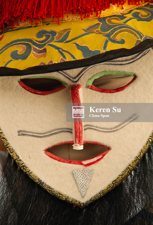 China, Tibet, details of colorful mask from Tibetan mask dance