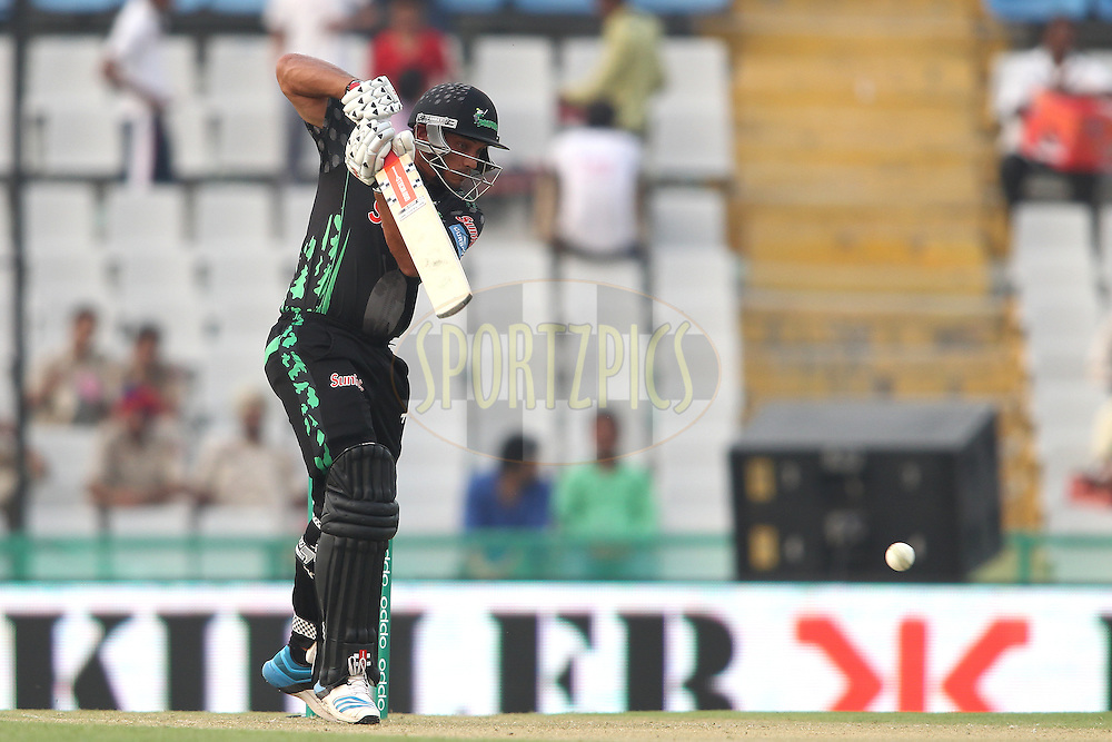 Vaughn van Jaarsveld of the Dolphins plays a delivery through to the covers during match 4 of the Oppo Champions League Twenty20 between the Dolphins and the Perth Scorchers held at the Punjab Cricket Association Stadium, Mohali, India on the 20th September 2014<br /> <br /> Photo by:  Shaun Roy / Sportzpics/ CLT20<br /> <br /> <br /> Image use is subject to the terms and conditions as laid out by the BCCI/ CLT20.  The terms and conditions can be downloaded here:<br /> <br /> http://sportzpics.photoshelter.com/gallery/CLT20-Image-Terms-and-Conditions-2014/G0000IfNJn535VPU/C0000QhhKadWcjYs