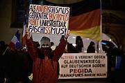 Frankfurt am Main | 02 Feb 2015<br /> <br /> Am Montag (02.02.2015) demonstrierten in Frankfurt an der Hauptwache etwa 60 PEGIDA-Anh&auml;nger mit teils extrem rassistischen Reden und Parolen z.B: gegen &quot;Islamisierung&quot;, an den Aktionen gegen die Rechtsextremisten nahmen mehrere tausend Menschen teil.<br /> Hier: PEGIDA-Demonstrant mit einem Transparent mit der Aufschrift 'Nein zu Islam-Nazis...'.<br /> <br /> &copy;peter-juelich.com<br /> <br /> [No Model Release | No Property Release]