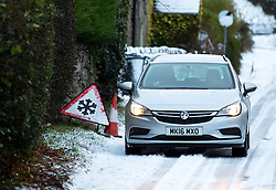 © Licensed to London News Pictures. 13/01/2017. Chesterfield, UK. Cars drive through the snow on the way through Curbar Gap, Derbyshire. Snowy and icy weather has resulted in some road closures in rural Derbyshire. Last night saw many parts of the UK covered in snow. Photo credit : Tom Nicholson/LNP