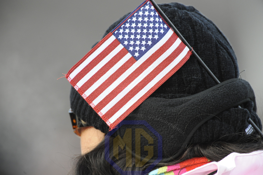 The American flag is worn in the hat of a member of the large crowd in front of the U.S. Capital during the swearing in of Barack Obama as the 44th President of the United States of America during his Inauguration Ceremony on Capitol Hill in Washington on January 20, 2009.    (Mark Goldman/ Goldmine Photos)