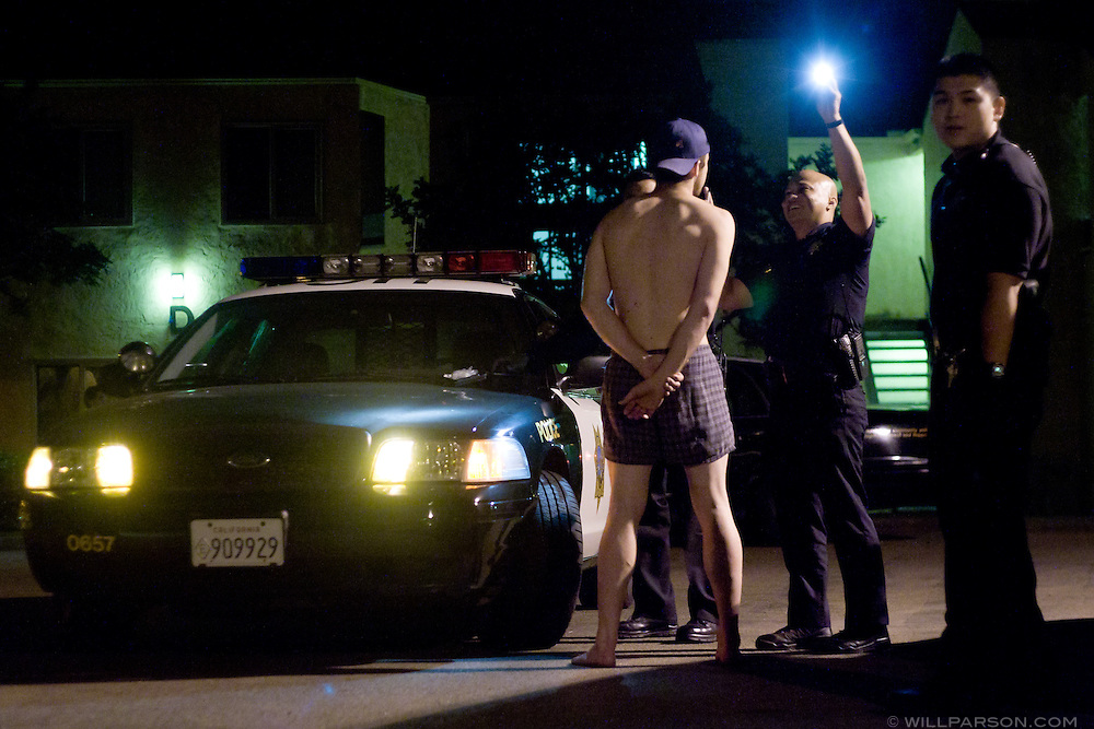 Campus police at UC San Diego examine the sobriety of a student after an Undie Run event, May 5, 2006.