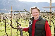 Italie, Margreid, Magr&egrave;, 20080403<br /> Wijndomein Alois Lageder.<br /> Bedrijfsleider Urs Vetter van het wijnhuis Alois Lageder. Hij staat in het voorjaar tussen de kale wijnranken in het veld. <br /> Het wijnhuis is als visionair reeds decennia geleden  omgeschakeld op duurzame, biologisch-dynamische wijnbouw van de hoogste kwaliteit.<br /> Mais hangt te drogen bij een wijnboer. <br /> Margreid an der Weinstra&szlig;e (Italiaans: Magr&egrave; sulla Strada del Vino) is een gemeente in de Italiaanse provincie Zuid-Tirol (regio Trentino-Zuid-Tirol), oftewel de regio Alto Adige in Noord-Itali&euml;.<br /> In de wijnlokalen kunt u genieten van lokale wijnen (Lagrein, Vernatsch en Gew&uuml;rztraminer) en van andere goede wijnen, zoals Pinot Blanc, Sauvignon Blanc, Merlot en Cabernet.<br /> <br /> Italy, Margreid, Magr&egrave;, 20080403<br /> Wijndomein Alois Lageder. <br /> Urs Vetter manager of the winery Alois Lageder. He stands in the spring between the bare vines in the field.  The winery is as visionary already been converted decades ago sustainable, biodynamic wine of the highest quality. Corn is drying at a winery. Margreid Weinstra&szlig;e (Italian Magr&egrave; sulla Strada del Vino) is a town in the Italian province of South Tyrol (Trentino-Alto Adige), or the region of Alto Adige in northern Italy. In the taverns you can taste local wines (Lagrein, Vernatsch and Gew&uuml;rztraminer) and other fine wines, such as Pinot Blanc, Sauvignon Blanc, Merlot and Cabernet.