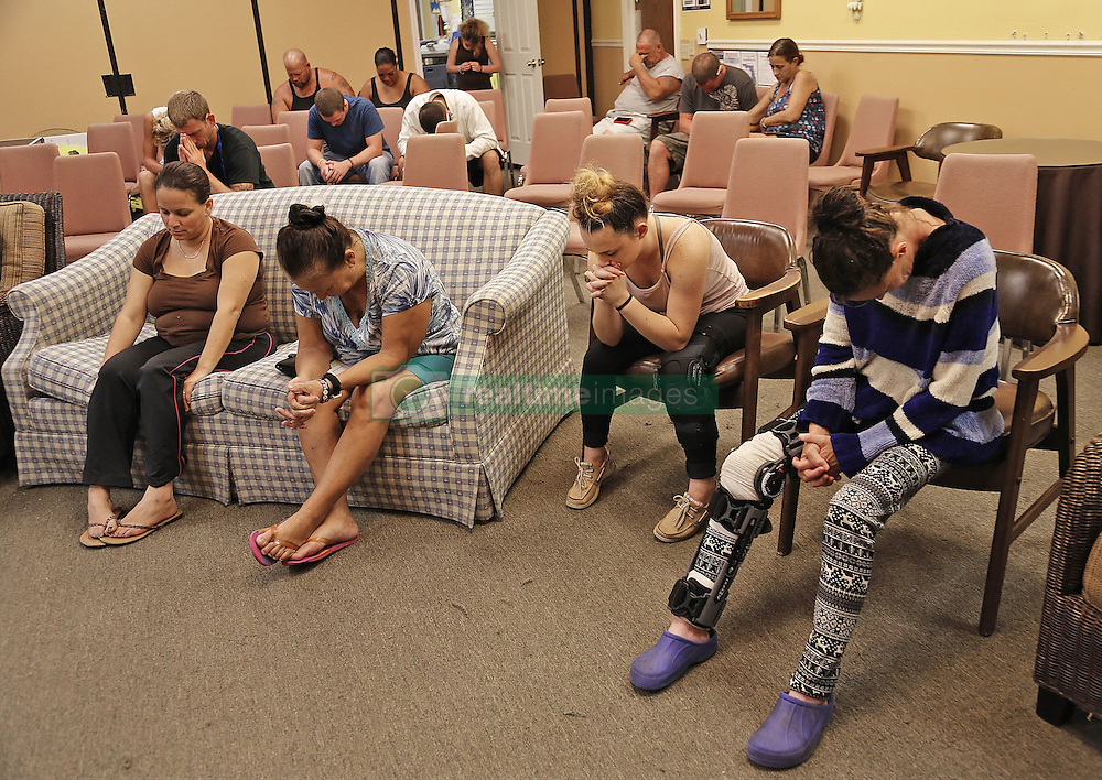 October 7, 2016 - Palm Bay, FL, USA - Residents at Tropical Inn Resort, a hotel and rehab facility, have a moment of prayer in preparation of upcoming Hurricane Matthew on Oct. 6, 2016 in Palm Bay, Fla. (Credit Image: © Carl Juste/TNS via ZUMA Wire)