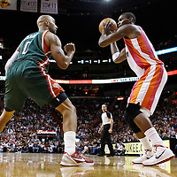 22 January 2012: Milwaukee Bucks power forward Drew Gooden (0) defends on Miami Heat power forward Chris Bosh (1) during the Milwaukee Bucks 91-82 victory over the Miami Heat at the AmericanAirlines Arena, Miami, Florida, USA.