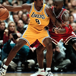 2-1-98-6--BULLS#2--KEITH BIRMINGHAM--TRIB<br /> INGLEWOOD: Kobe Bryant (8) of the Lakers goes up against Michael Jordan (23) of the Bulls in the lakers Sunday afternoon win.