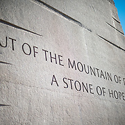 "An inscription on the side of the base of the statue of civil rights leader Dr Martin Luther King Jr emerging out of the Stone of Hope that forms the centerpiece of the MLK Memorial on the banks of the Tidal Basin in Washington DC. The sculpture was created by Chinese sculptor Lei Yixin. The inscription reads: ""Out of the mountain of despair a stone of hope."""