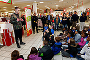 "Corporate Event and Promotional Marketing Photographer in Kansas City - KC Chiefs' Travis Kelce, participates in ""Giving Tuesday"" helping kids from the Boys & Girls Clubs of Greater Kansas City shop for holiday gifts for their families, at the Bolger's Square JCPenney store in Independence, Mo. Photo by Colin E. Braley for JCPenny"