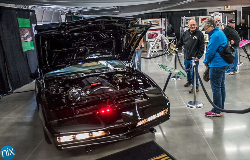 """Car enthusiast browse a display featuring KITT from the 1908s television show """"Knight Rider"""" during the Charlotte AutoFair at Charlotte Motor Speedway Thursday morning."""