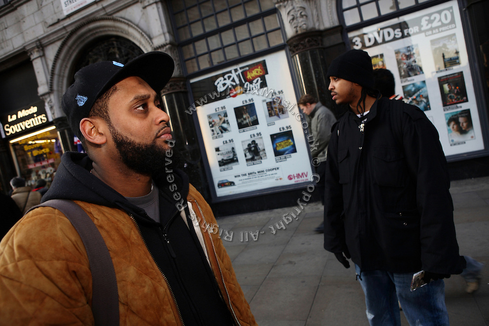 Cataclysm, 27, (left) and Iron Braydz, 26, (right) are waiting for people in the street to present Blind Alphabetz?s new album on Wednesday, Feb. 7, 2007, in London, England. Islamic Hip Hop artists like the duo 'Blind Alphabetz', from London, feel more than ever the need to say what they think aloud. In the music industry the backlash of a disputable Western foreign policy towards Islamic countries and its people is strong. The number of artists in the European Union and the US taking this into consideration and addressing the current social and political problems within their lyrics is growing rapidly and fostering awareness for Muslim and others alike.
