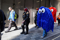© Licensed to London News Pictures. 08/04/2017. London, UK. Participants take part in the inaugural Games Character Parade, walking from Guildhall to Paternoster Square.  The event formed part of the London Games Festival welcoming cosplayers, wearing costumes inspired by videogame characters, to the UK's biggest parade of cosplayers.   Photo credit : Stephen Chung/LNP