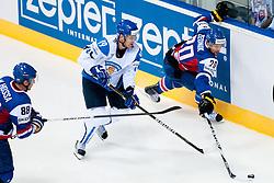 Jyrki Valivaara of Finland and Richard Zednik of Slovakia during ice-hockey match between Finland and Slovakia of Group E in Qualifying Round of IIHF 2011 World Championship Slovakia, on May 7, 2011 in Orange Arena, Bratislava, Slovakia. (Photo by Matic Klansek Velej / Sportida)