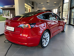 MANCHESTER, ENGLAND - Monday, December 17, 2018: The Tesla Model 3 car on display in red at the Manchester Tesla showroom, one of only two Model 3 cars in the UK, ahead of its European launch. (Pic by David Rawcliffe/Propaganda)