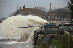© London News Pictures. 31/01/2014. Burrowbridge, UK. Pumps being used to move flood water from the village of Burrowbridge in Somerset on the Somerset levels.  The area has been hit severely by recent flooding which is forecast to get worse over the weekend . Photo credit: Jason Bryant/LNP