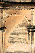 KADIRI, INDIA - 23rd October 2019 - Close-up wall texture of archway stone carving at Bangalore fort, Bengaluru, Karnataka, India, South India