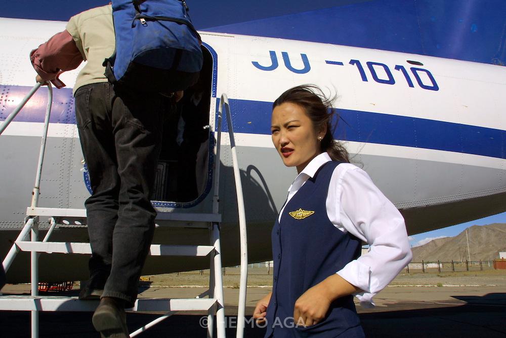 GOBI DESERT, MONGOLIA..09/03/2001.Bayanhongor (Bayankhongor). MIAT Antonov 24 to Ulaan Baatar. Stewardess..(Photo by Heimo Aga).