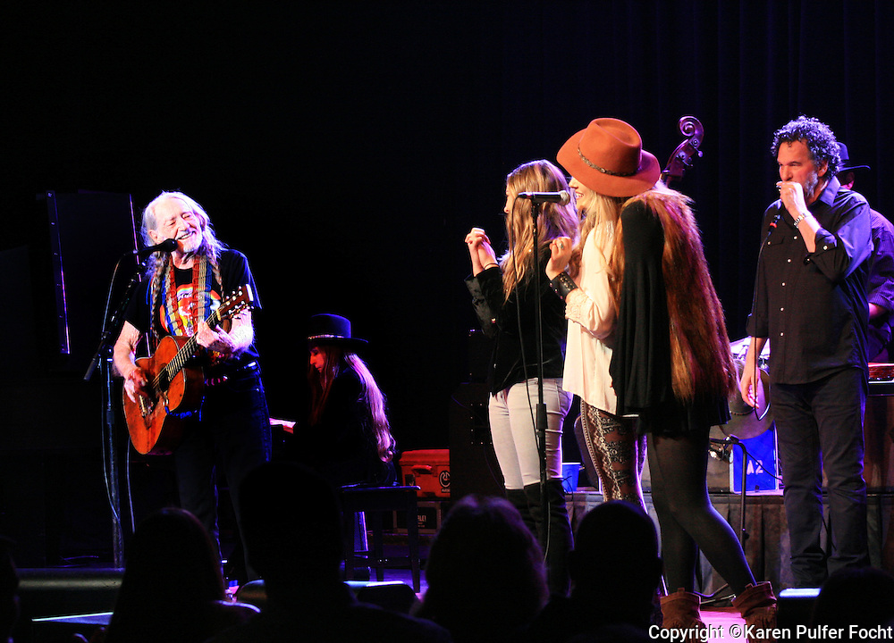WILLIE NELSON performs in Tunica, Mississippi at the Horseshoe Casino on Jan. 6th 2017. He is backed up by the girl band Runaway June from Nashville. Naomi Cooke, Hannah Mulholland, and Jennifer Wayne, granddaughter of John Wayne at right.  (Photo by Karen Pulfer Focht ©)