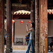 Tourist takes a photo at Longshan Temple, Lugang, Changhua County, Taiwan