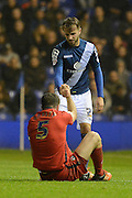 Birmingham City midfielder Andrew Shinnie helps up Blackburn Rovers defender Grant Hanley during the Sky Bet Championship match between Birmingham City and Blackburn Rovers at St Andrews, Birmingham, England on 3 November 2015. Photo by Alan Franklin.