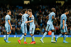 Jose Angel Pozo of Manchester City celebrates with Jesus Navas after scoring a goal to make it 6-0 - Photo mandatory by-line: Rogan Thomson/JMP - 07966 386802 - 24/08/2014 - SPORT - FOOTBALL - Manchester, England - Etihad Stadium - Manchester City v Sheffield Wednesday - Capital One Cup, Third Round.