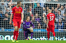 19.10.2013, St. James Park, New Castle, ENG, Premier League, ENG, Premier League, Newcastle United vs FC Liverpool, 8. Runde, im Bild Liverpool's goalkeeper Simon Mignolet looks dejected as Newcastle United score the opening goal // during the English Premier League 8th round match between Newcastle United and Liverpool FC St. James Park in New Castle, Great Britain on 2013/10/19. EXPA Pictures © 2013, PhotoCredit: EXPA/ Propagandaphoto/ David Rawcliffe<br /> <br /> *****ATTENTION - OUT of ENG, GBR*****