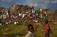 Children play in the Pechinat tent camp in Jacmel. The 7.0 earthquake that devastated parts of Haiti on January 12 killed hundreds of thousands of people. January's earthquake killed hundreds of thousands of people and caused significant and lasting structural and economic damage in the Caribbean nation.