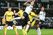 Derby County defender Craig Forsyth (3) wins a header  during the EFL Sky Bet Championship match between Derby County and Millwall at the Pride Park, Derby, England on 14 December 2019.