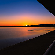 """""""Balcony Sunrise""""<br /> <br /> Enjoy this stunning sunrise and silhouette from the balcony of Grand Beach Resort on Grand Traverse Bay in Traverse City, Michigan!"""