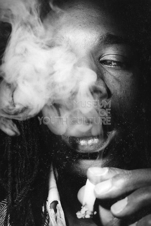 Rastafarian poet, Benjamin Zephaniah, Smoking a large Spliff, UK, 1980's.