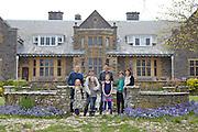 The Elliott and Baker families in the garden at Pickwell Manor. From left to right: Richard Eliott, Millie-grace Elliott (8), Tracey Elliott, Molly Elliott (10), Steve Baker, Liza Baker (9), Zac Baker (11), Susannah Baker. Pickwell Manor, Georgeham, North Devon, UK.<br /> CREDIT: Vanessa Berberian for The Wall Street Journal<br /> HOUSESHARE