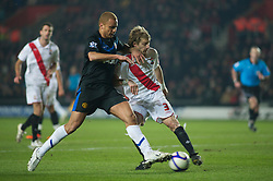 SOUTHAMPTON, ENGLAND - Saturday, January 29, 2011: Manchester United's Wes Brown and Southampton's Daniel Harding in action during the FA Cup 4th Round match at St. Mary's Stadium. (Photo by Gareth Davies/Propaganda)