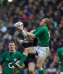 09.02.2013 Edinburgh, Scotland.   Scotland's Sean Lamont beats Ireland's Keith Earls to the ball  during the RBS Six Nations Championship match between Scotland and Ireland, from Murrayfield Stadium.