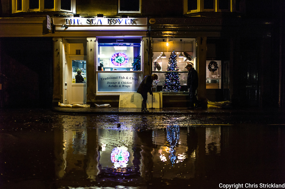 Jedburgh, Scottish Borders, UK. 21st December 2013. A street is flooded outside the Sea Rover fish and chip shop after the town of Jedburgh was flooded.