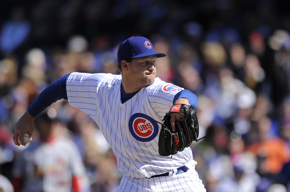 CHICAGO - APRIL 16:  Aaron Heilman #47 of the Chicago Cubs pitches against the St. Louis Cardinals on April 16, 2009 at Wrigley Field in Chicago, Illinois.  The Cardinals defeated the Cubs 7-4.  (Photo by Ron Vesely)