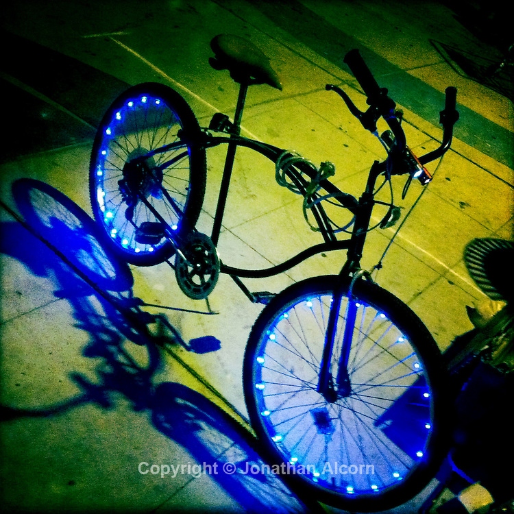 Lights on the wheels of a bicycle in  Venice Beach