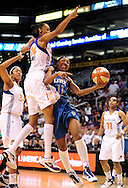 Sep 11, 2011; Phoenix, AZ, USA; Minnesota Lynx guard Candice Wiggins (11) drives the ball against the Phoenix Mercury guard .DeWanna Bonner (24) during the first half at the US Airways Center.  The Lynx defeated the Mercury 96-90. Mandatory Credit: Jennifer Stewart-US PRESSWIRE
