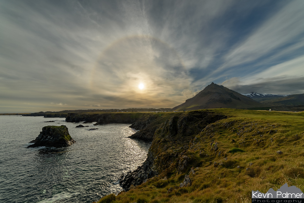 This halo stayed in the sky for most of the evening over the Icelandic village of Arnarstapi. The pyramid-shaped mountain is Stapafell, which is a lower peak of the glacier-capped Snæfellsjökull volcano behind it.