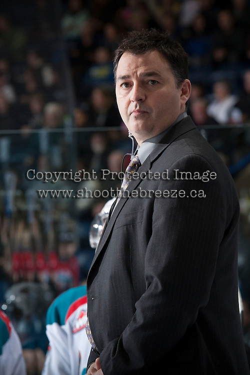 KELOWNA, CANADA - JANUARY 24:  Dan Lambert, coach of the Kelowna Rockets stands on the bench opposite the Seattle Thunderbirds at the Kelowna Rockets on January 24, 2013 at Prospera Place in Kelowna, British Columbia, Canada (Photo by Marissa Baecker/Shoot the Breeze) *** Local Caption ***