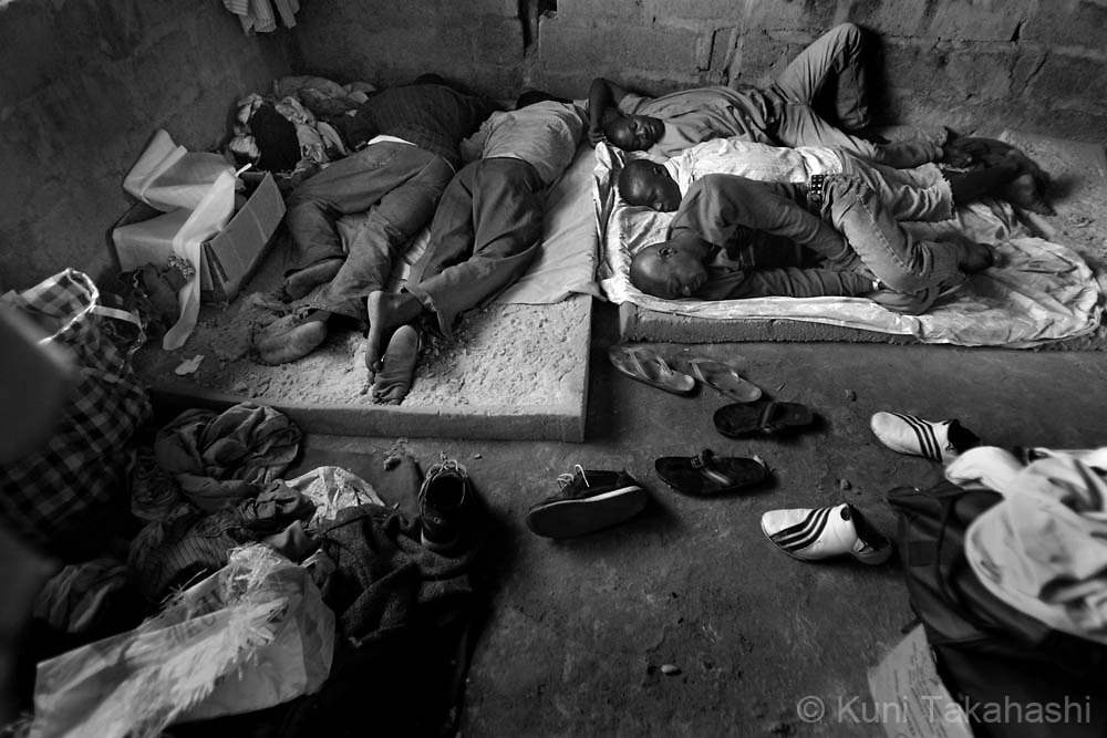 Ex-combatants, who with the assistance of local churches live together in the outskirts of Monrovia, Liberia, lie down on worn out sponges on  May 1, 2008.  Although the country's 14-year civil war ended in 2003, many ex-combatants are still struggling to survive due to the lack of jobs in a weak economy..
