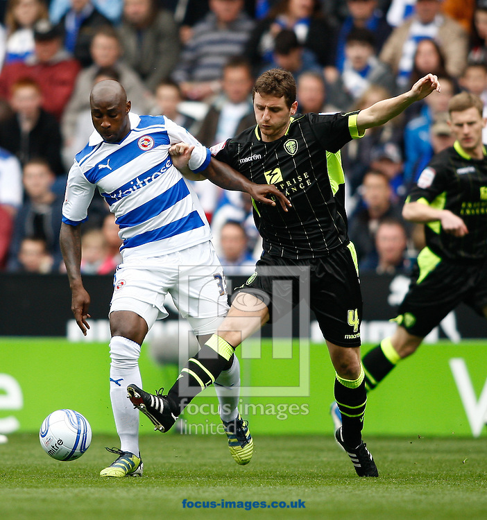 Picture by Andrew Tobin/Focus Images Ltd. 07710 761820. 6/4/2012 - Jason Roberts of Reading is challenged by Alex Bruce of Leeds during the Npower Championship match at Madejski stadium, Reading.
