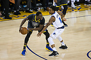 Golden State Warriors forward Draymond Green (23) looks for an open teammate during a NBA game against the Dallas Mavericks at Oracle Arena in Oakland, California, on February 8, 2018. (Stan Olszewski/Special to S.F. Examiner)