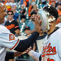 BALTIMORE, MD - AUGUST 23: Baltimore Orioles second baseman Jonathan Schoop (6) hits Baltimore Orioles third baseman Manny Machado (13) with a pie after his walk off home run in the twelfth inning during an MLB game between the Oakland Athletics and the Baltimore Orioles on August 23, 2017, at Orioles Park at Camden Yards in Baltimore, MD. The Baltimore Orioles defeated the Oakland Athletics, 8-7 in twelve innings.  (Photo by Mark Goldman/Icon Sportswire)