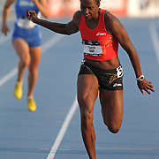 DAY -13USA, Des Moines, Ia.- Sharon Day leans at the finish line of the heptathlon 200.  Photo by David Peterson