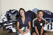 Brittnay and Devon Climmons sit with some of their sports equipment, Saturday, August 11, 2007.