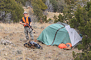 After setting up a backcountry camp in the hills east of Dillon, Montana, hunter Josh Falkos prepares to head out in search of mule deer and elk.