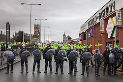 © Licensed to London News Pictures . Bolton, UK . FILE PHOTO DATED 20/03/2010 of police at an English Defence League demonstration in Bolton as today (30th August 2013) it's been revealed that Greater Manchester Police have paid out tens of thousands of pounds in return for protestors not pursuing civil claims against them following arrests made at the demonstration in March 2010 . Photo credit : Joel Goodman/LNP