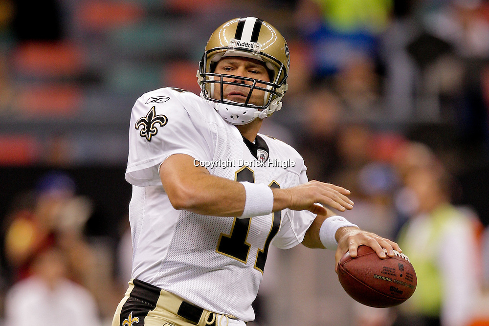 2009 September 13: New Orleans Saints quarterback Mark Brunell (11) during warm ups before a week one regular season game between the New Orleans Saints and the Detroit Lions at the Louisiana Superdome in New Orleans, Louisiana.