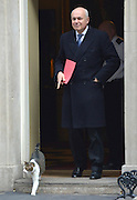 © Licensed to London News Pictures. 05/03/2013. Westminster, UK. Work & Pensions Secretary.Iain Duncan Smith is upstaged by the Prime Ministers cat, Larry, as he leaves Downing Street. Ministers after a Cabinet Meeting at number 10 Downing Street on 5th March 2013. Photo credit : Stephen Simpson/LNP